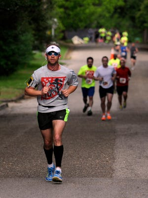 Runners compete in the Jubilee Run on Saturday, May 17, 2014.