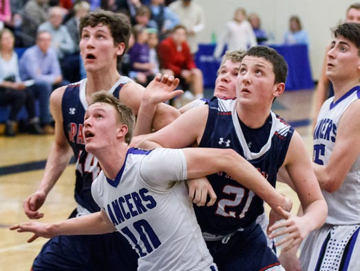 Brookfield Central senior Sam Rohde (10) boxes out