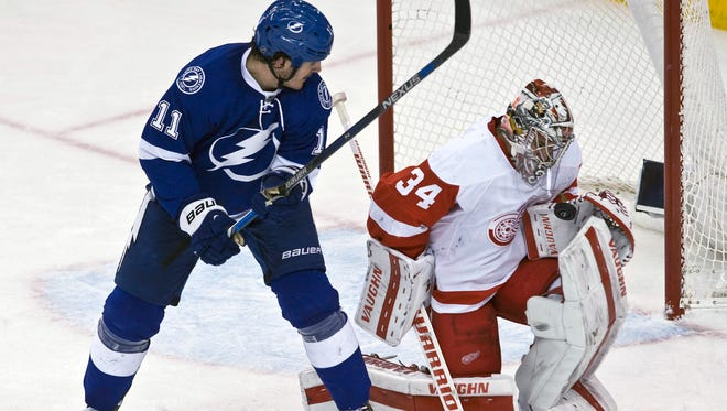 Detroit Red Wings goalie Petr Mrazek (34) stops a shot from Tampa Bay Lightning's Brian Boyle (11) during the second period.