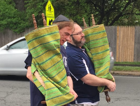 Torahs are walked to new home