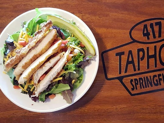 417 Taphouse goes beyond standard bar fare, serving up fresh salads like this grilled chicken version.