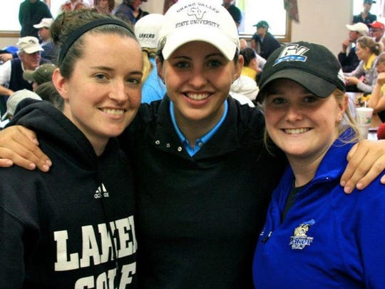 Former Grand Valley State players Allie Tyer (left) and Caitlin Bennett (right) support Hoffman at a Symetra stop.