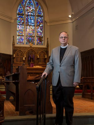 Father Dirk C. Reinken photographed in St. Peter's Episcopal Church. 