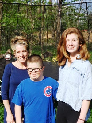 Heidi Terselic helped coordinate the St. Columban student outreach at Loveland Intermediate School with her special-needs son Augie and his sister Millie Terselic.