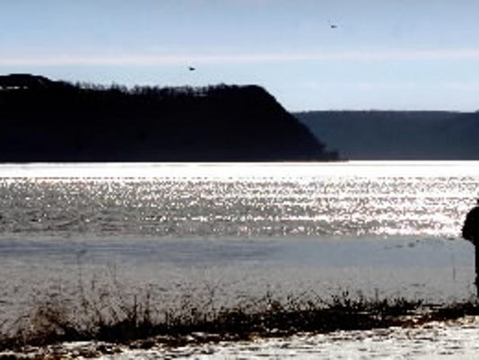 Flanked by two wind turbines, Turkey Point is silhouetted behind the eastern shore of the Susquehanna River in Manor Township, Lancaster County. A proposal would increase the height of the landfill by 50 feet.