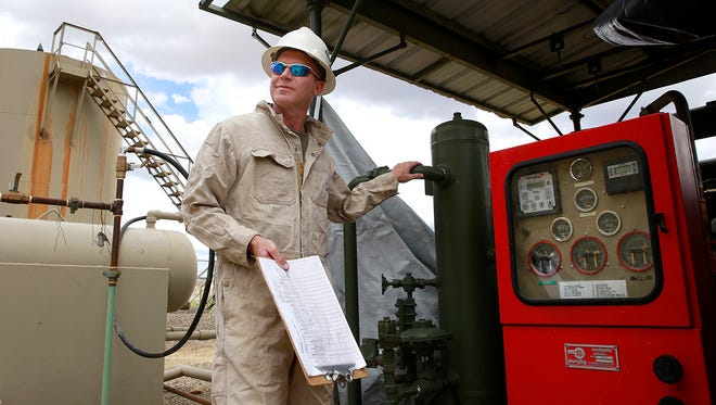 Tom Mullins, owner/operator of Synergy Operating LLC, at one of the company's gas wells on May 17 near La Plata Highway and Twin Peaks Boulevard. With slumping commodities prices, more wells like this are being shutin, which means no profits and no royalties paid to the state.