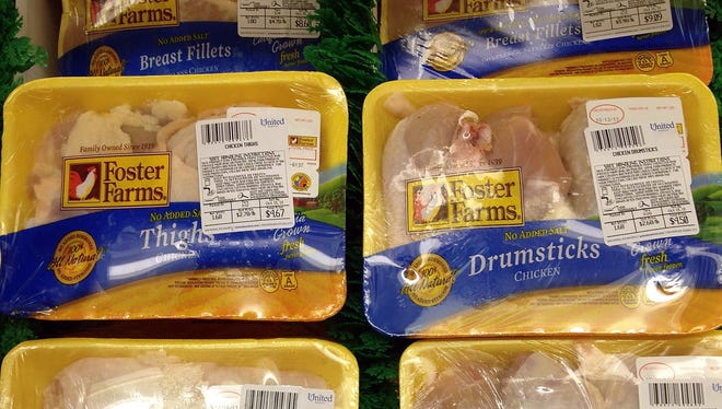 Packages of Foster Farms chicken are for sale in a cooler at a grocery store on Oct. 9, 2013, in San Anselmo, Calif. The U.S. Department of Agriculture is  threatening to shutter three Foster Farms chicken-processing plants in California over salmonella illnesses.