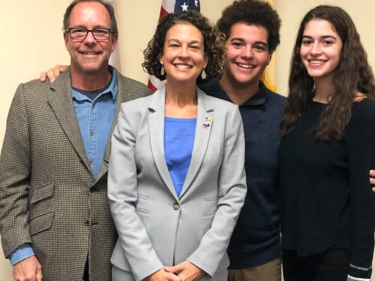 Amalia Duarte, the first Democrat to be elected to the Mendham Township Committee, was sworn-in Friday with her husband, Gene Messina, son, Matthew Messina, and daughter, Elena Messina, at her side.