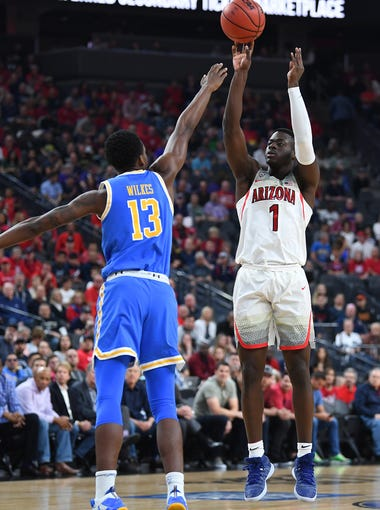 Mar 9, 2018; Las Vegas, NV, USA; Arizona Wildcats guard Rawle Alkins (1) shoots against UCLA Bruins guard Kris Wilkes (13) during a semi-final match of the Pac-12 Tournament at T-Mobile Arena. Mandatory Credit: Stephen R. Sylvanie-USA TODAY Sports