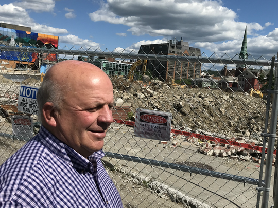 Former Burlington Mayor Peter Clavelle stands beside the construction site for CityPlace, a controversial project for which he served as a mediator. Photographed June 25, 2018.
