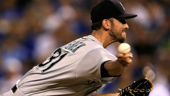 Seattle Mariners relief pitcher Steve Cishek delivers to a Kansas City Royals batter during the ninth inning of a baseball game at Kauffman Stadium in Kansas City, Mo., Friday, July 8, 2016. (AP Photo/Orlin Wagner)