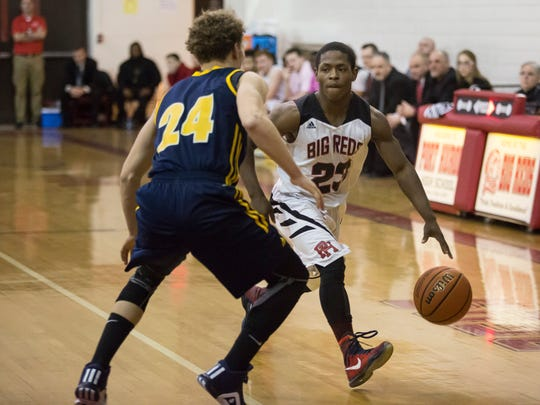 Port Huron senior Jermaine Drake works the ball past Northern senior Geryd Welsh during a basketball game Thursday, March 3, 2016 a Port Huron High School.