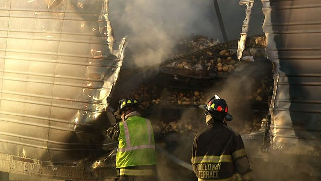 A truck carrying potatoes caught fire on I-295 near New Castle Thursday morning.