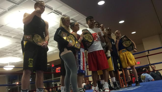 Boxers pose for photograph following the matches at the Iowa Golden Glove Championships on Saturday, April 4, 2015.