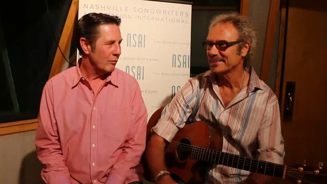 """Bart Herbison, left, talks to David Jenkins about co-writing """"Love Will Find a Way"""""""