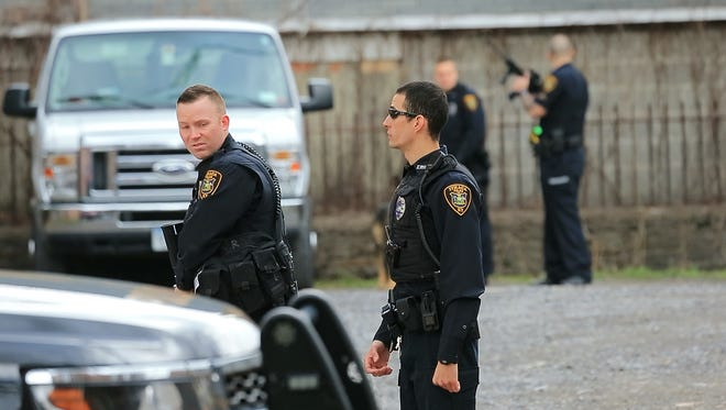Ithaca police on State Street between Cayuga and Geneva streets after a report of a man with a gun.