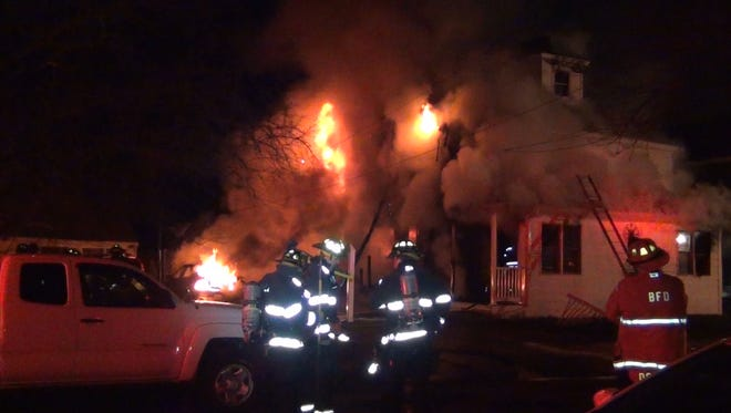 Burlington firefighters attempt to knock down a fire at 135 Hayward Street in the city this spring.