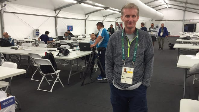 Jeff Metcalfe, working at his 13th Olympics at Rio swimming media center.