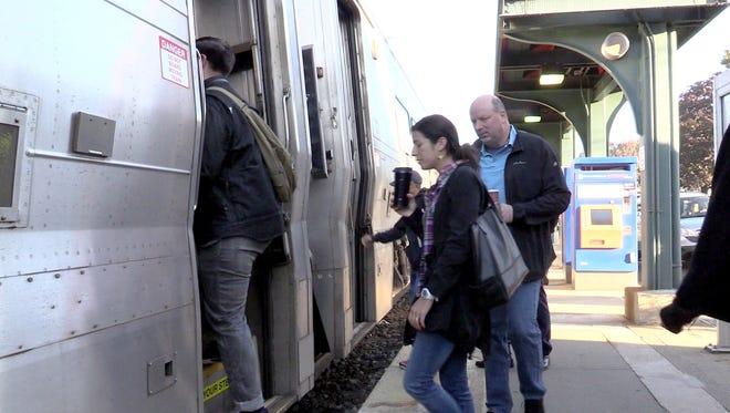 Commuters board an NJ Transit train in Pearl River Oct. 7, 2016.