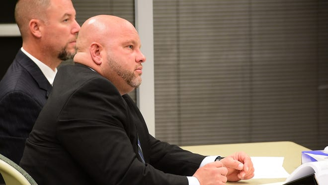 Kyle Overmyer, suspended sheriff of Sandusky County, appears in court on a bond revocation motion on Nov. 3, 2016. Overmyer was indicted Aug. 23 on 43 criminal counts, including 38 felonies, alleging he stole prescription take-back boxes from area police departments, deceived physicians to obtain prescription pain medication and tampered with records regarding the sheriff's Furtherance of Justice account.