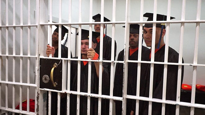 """Inmates await release for a graduation ceremony in the documentary """"A High School Behind Bars."""""""