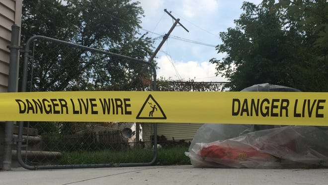 Yellow tape marks an area where power lines are damaged in this Sept. 10, 2014 photo.