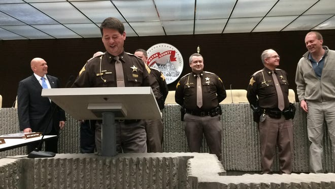 Sheriff Jeff Cappa speaks during a ceremony where the Wayne County Jail was awarded a plaque for receiving legal-based accreditation. Behind Cappa are (from left) Tate McCotter, executive director of the National Institute for Jail Operations; Ken Paust, president of the county commissioners; Lt. Travis Isaacs, assistant jail commander; Capt. Andy Abney-Brotz, jail commander; Major Mike Frame, chief deputy; and Peter Zaleski, president of county council.