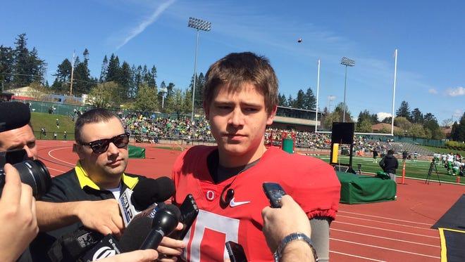 Oregon quarterback Justin Herbert talks to the media Saturday at Jesuit High School.