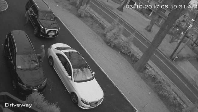Still frame from video footage of car looters taken advantage of open cars provided by  Westchester County District Attorney Anthony Scarpino's office on Apr. 20, 2017.