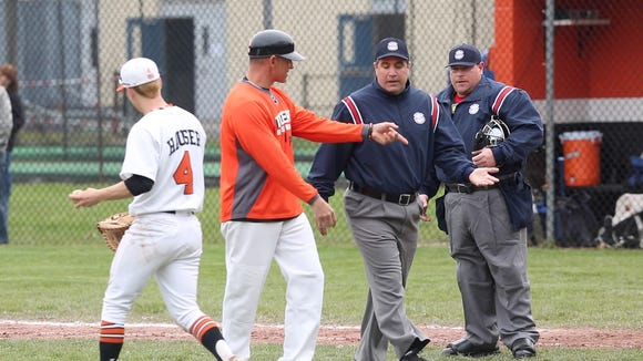 From left, White Plains' coach Marcel Galligani discuss