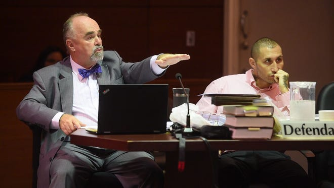Attorney Curtis Van de veld, left, cross examines prosecution witness Dr. Aurelio Espinola, Guam's chief medical examiner, during the murder trial of his client Allan Agababa on Thursday, Sept. 14, 2017, at the Superior Court of Guam. Espinola stood by his opinion that Agababa's mother, Shelly Bernstein, died from severe head injury, but also said he couldn't rule out fentanyl overdose.