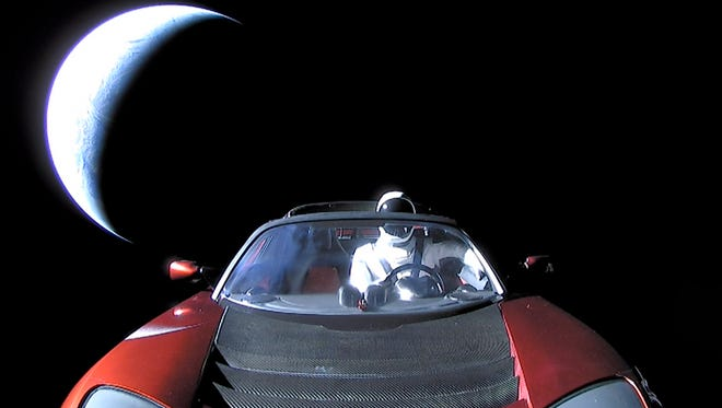 "The last photo of ""Starman"" in the Tesla Roadster on its way to the asteroid belt."