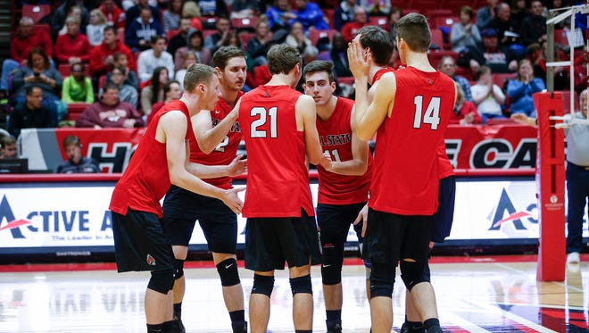 The Ball State volleyball team huddles up during a match earlier this season.