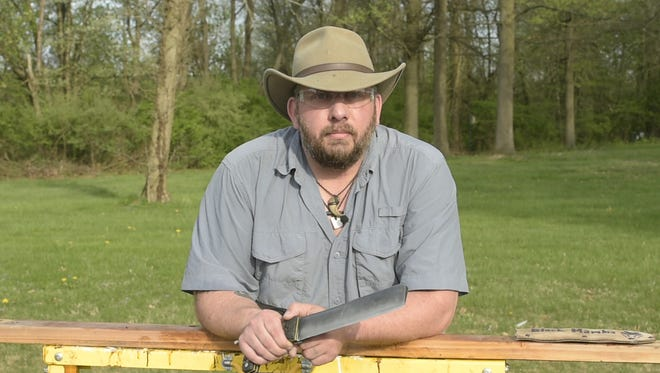 Dwayne Unger, of New Oxford, shows off his knife skills at Codorus State Park on May 2, 2018. Unger competed on and won the May 8 episode of Forged in Fire: Knife or Death on The History Channel and will advance to the final round and a shot at $20,000.