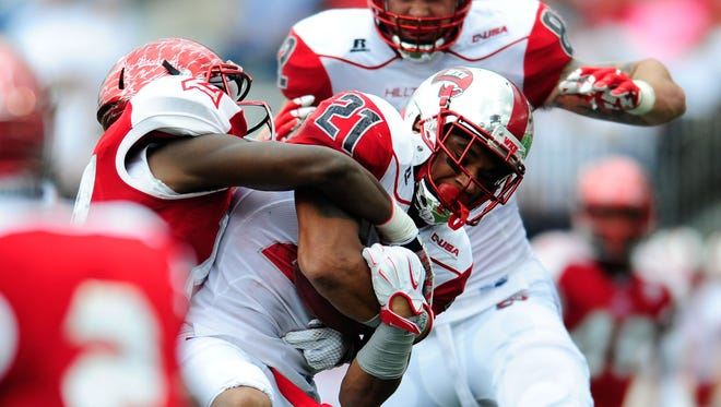 Sep 26, 2015; Bowling Green, KY, USA; Miami (Oh) Redhawks defensive back Tony Reid (14) tackles Western Kentucky Hilltoppers wide receiver Jared Dangerfield (21) during the first half at Houchens Industries-L.T. Smith Stadium. Mandatory Credit: Joshua Lindsey-USA TODAY Sports