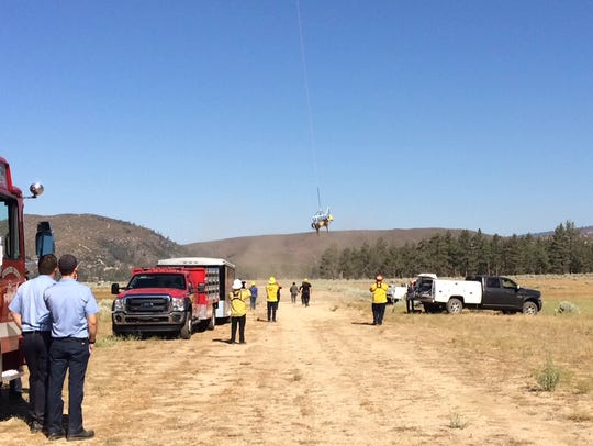 A horse is airlifted out of a canyon near Lake Hemet