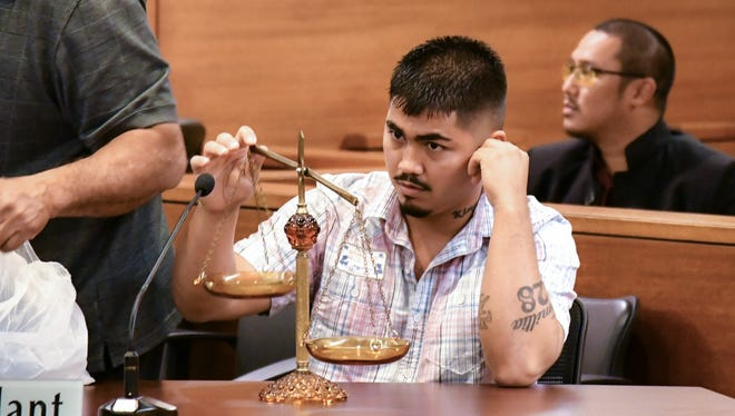Liberty Joe Concepcion, who faces three counts of assault for the Oct. 2016 Linda's riot, right, waits for closing arguments at the Superior Court of Guam on Jan. 12.