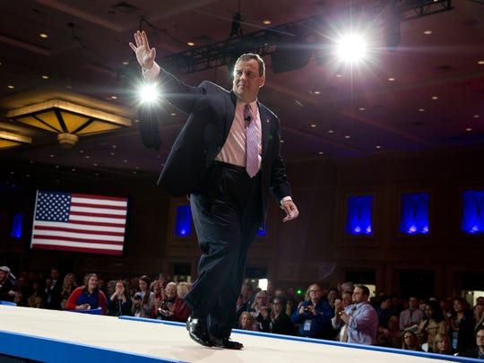 Gov. Chris Christie waves as he walks from the stage after speaking during the Conservative Political Action Conference in Maryland in February (file photograph).