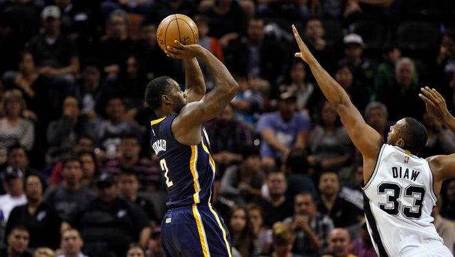Indiana Pacers point guard Rodney Stuckey (2) shoots the ball over San Antonio Spurs power forward Boris Diaw (33) during the second half at AT&T Center. Mandatory Credit: Soobum Im-USA TODAY Sports