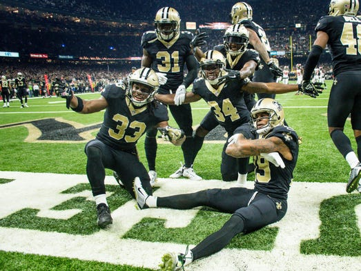 Saints Defensive players celebrate in the endzone after