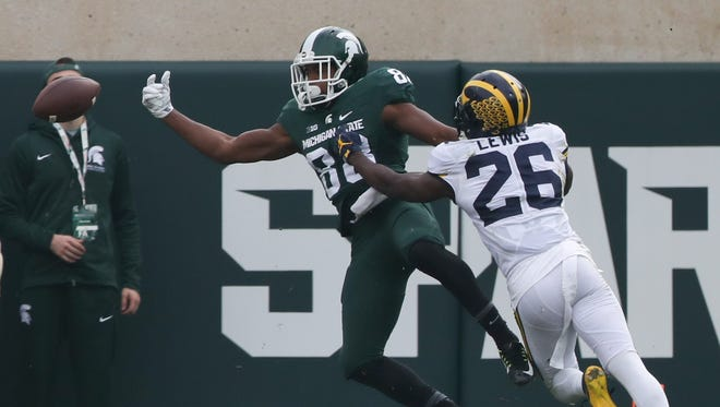 Michigan Wolverines cornerback Jordan Lewis defends against Michigan State Spartans receiver Monty Madaris during the fourth quarter Saturday, Oct. 29, 2016 at Spartan Stadium in East Lansing.