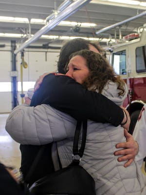 Barbara Gebnar hugs firefighter Mike Authier in Livonia's fire station 1. Authier was one of the firefighters who rescued her and her husband from a house fire last month.