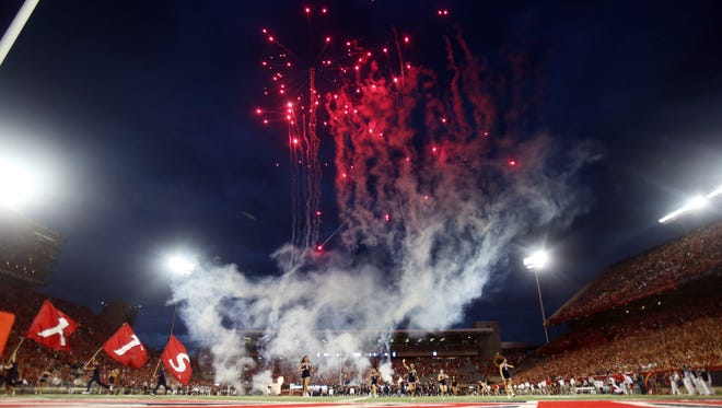 Fireworks fly as the game starts during the Arizona vs. Northern Arizona football game in Tucson, Ariz., on Friday, Aug. 30, 2013.