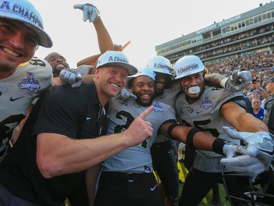 UCF Knights head coach Scott Frost celebrates with
