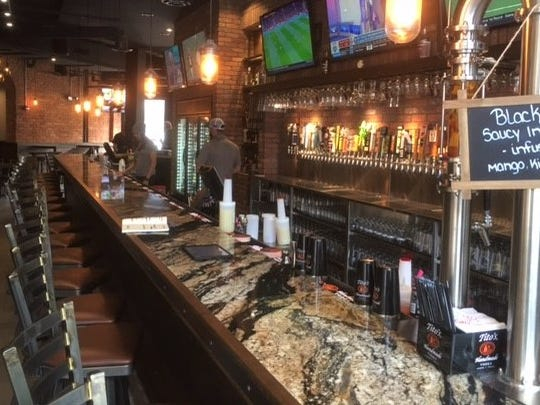 Sixteen of the 50 beers on tap at World of Beer on Mass Ave. are brewed in Indianapolis, including 3 Floyds Zombie Dust. World of Beer opened April 23, 2018, on Mass Ave. in Indianapolis.