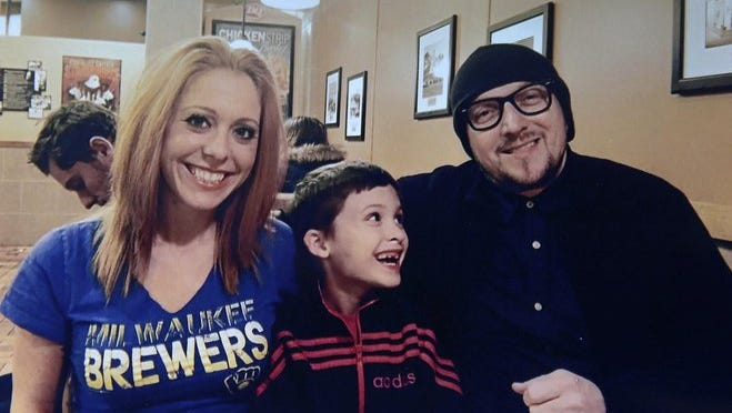 Melynda Treu is pictured with her husband, Andy Phillips, and her nephew Eric Treu. Eric's father died of an overdose in January. Melynda and Andy are now raising the 7-year-old. Her mother, Robin, died from a heroin overdose in 2009.