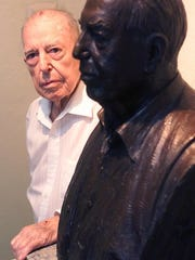 Renowned El Paso artist Tom Lea poses with a bust of himself Aug. 4, 2000, in El Paso. The bust was fashioned in 1995 by sculptor John Houser.