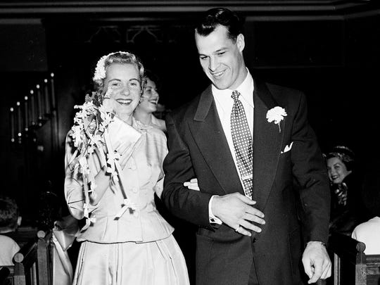 Gordie Howe marches down the aisle with his bride Colleen Joffa on April 15, 1953, in Detroit.