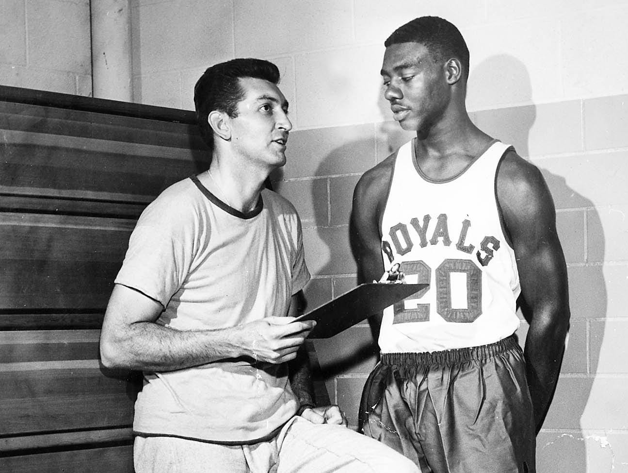 Charley Wolf talks with Oscar Robertson in 1960. Wolf had six boys and coached pro basketball for the Royals and Pistons.