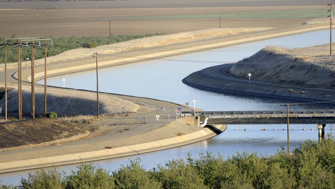 In this Oct. 2, 2009, file photo, in California's Westland Water District of the Central Valley, canals carry water to Southern California.